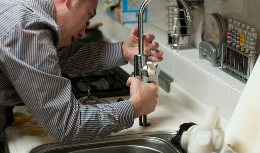 image of plumber working in the house